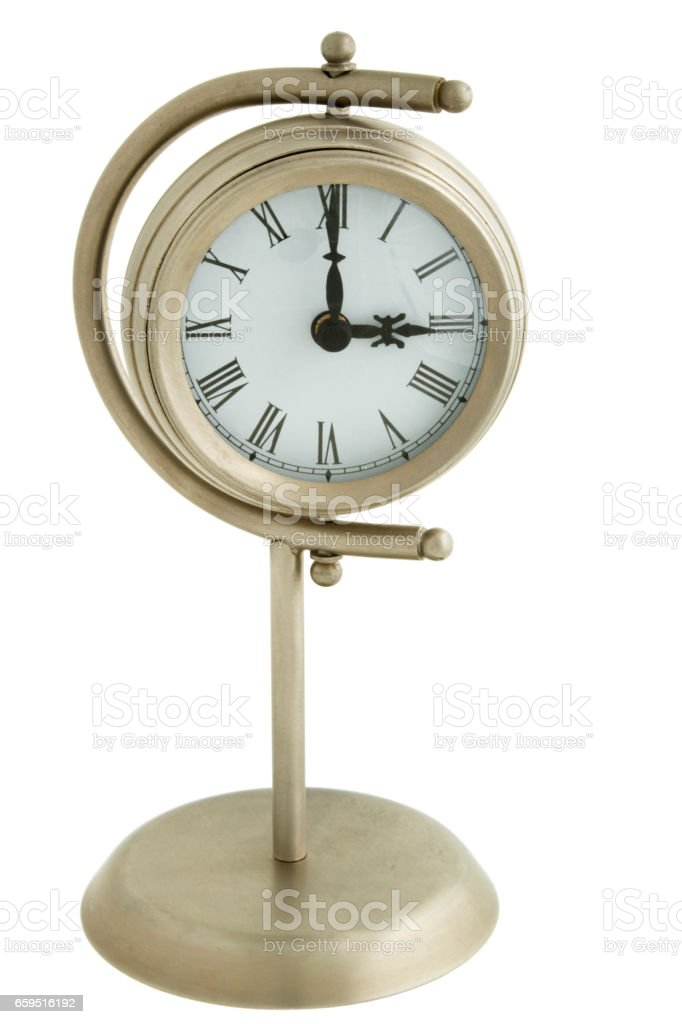 Table Clock on stand, with time showing three o'clock stock photo