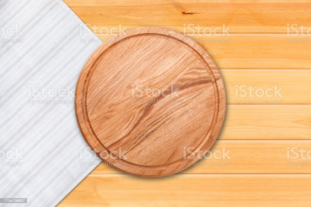 Table cloth and pizza board on vintage wooden table. Top view mock up