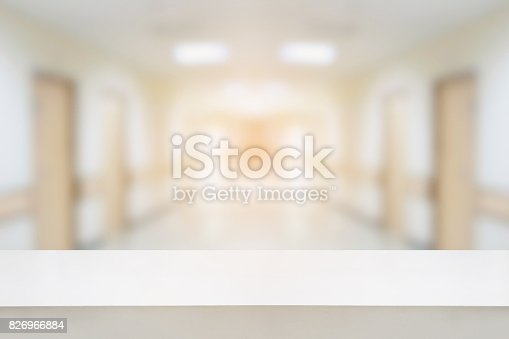 istock table counter with hospital interior corridor background 826966884