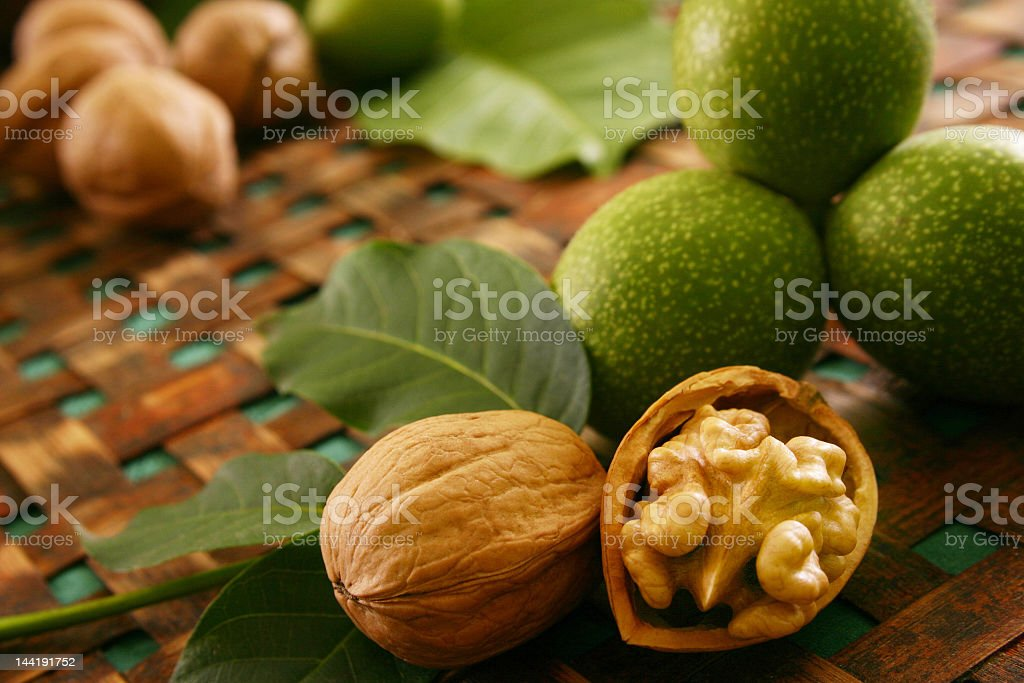 Table decorated with nuts and leaves around stock photo