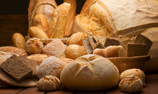 table decorated with various artisan breads produced with studio light.