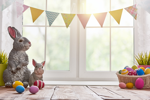 Happy Easter! Background with colorful eggs in basket. Table decorating for holiday.