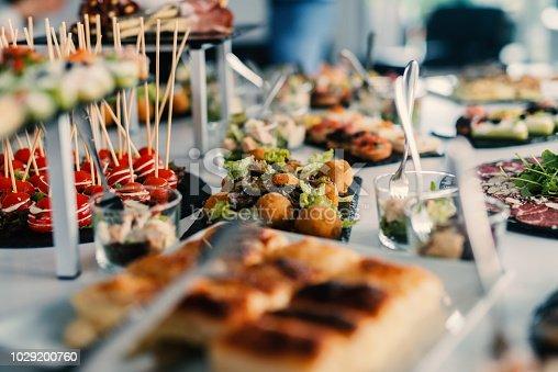 istock Table decoration of beautiful tasty food on celebration day. 1029200760
