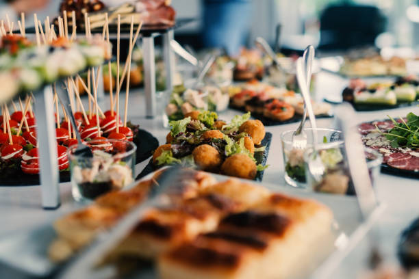 Table decoration of beautiful tasty food on celebration day. Table decoration of beautiful tasty food on celebration day. buffet stock pictures, royalty-free photos & images
