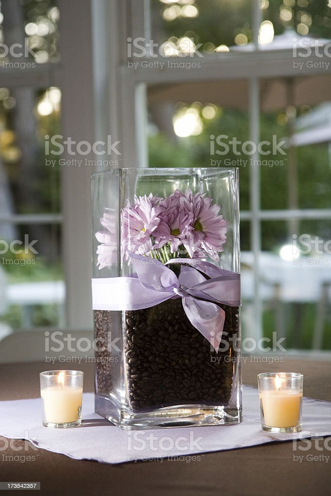 Table Decoration with Flowers and Candles by French Window royalty-free stock photo