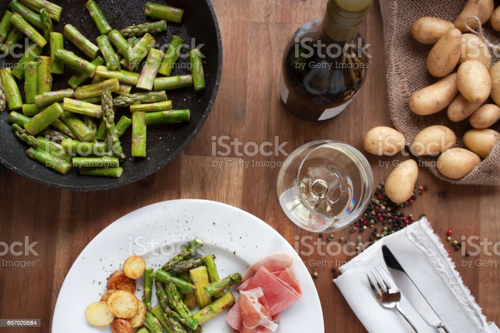 Table decoration with fried asparagus stock photo