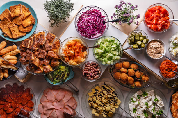 Table filed with large variety of food view  from above. kitchen table background top view stock photo