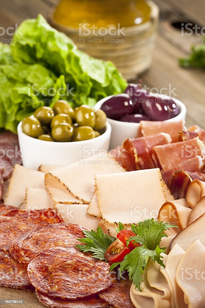 Table filled with delicious cold appetizers stock photo