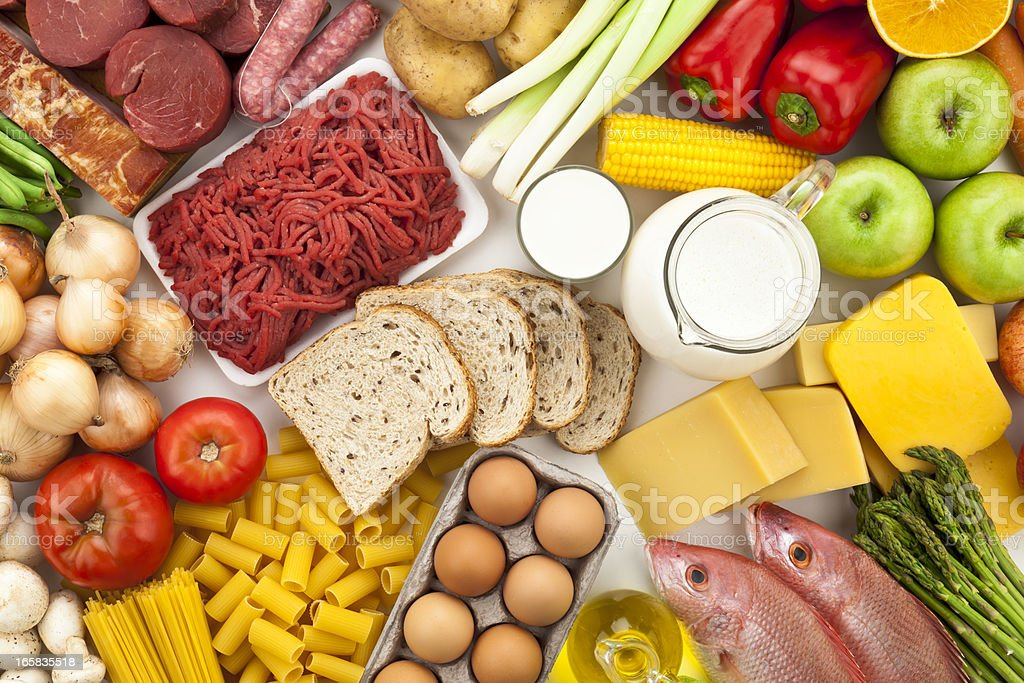 Table filled with different types of foods shot directly above stock photo