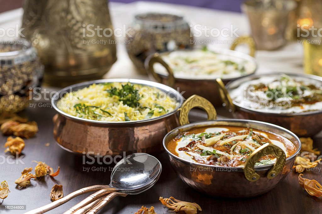 Table filled with freshly made Indian food stock photo
