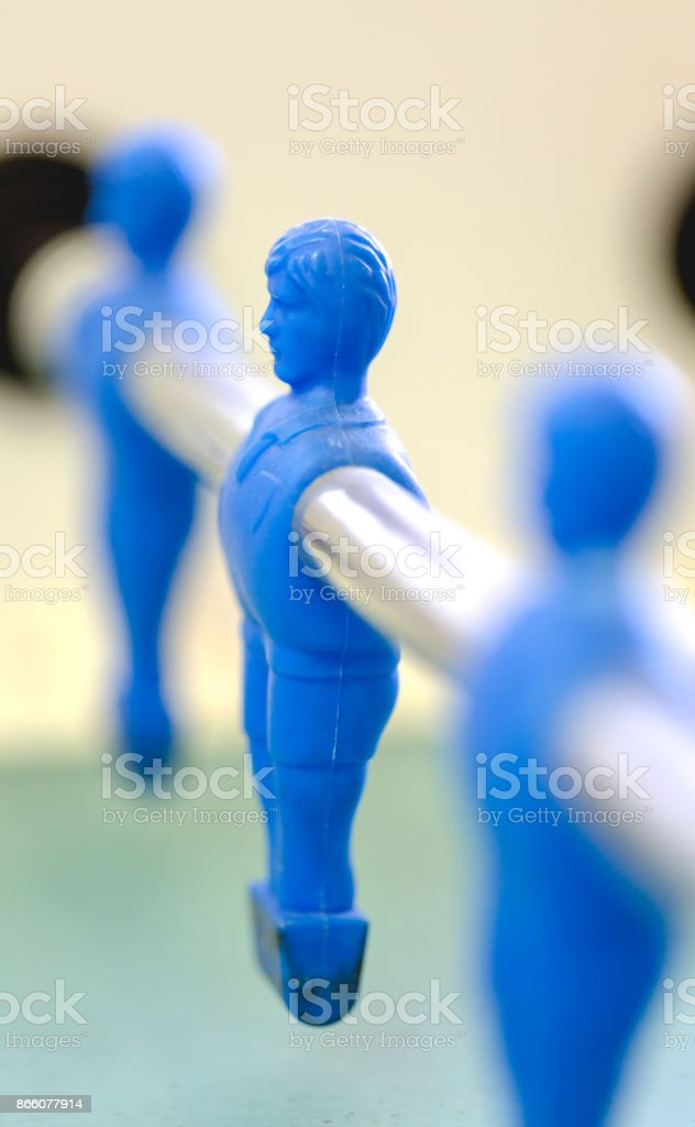 Table football, fusbal red and blue players in macro view stock photo