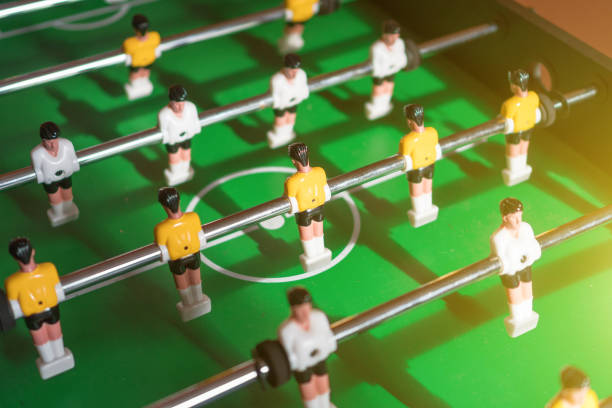 Table football game with yellow and white players. stock photo