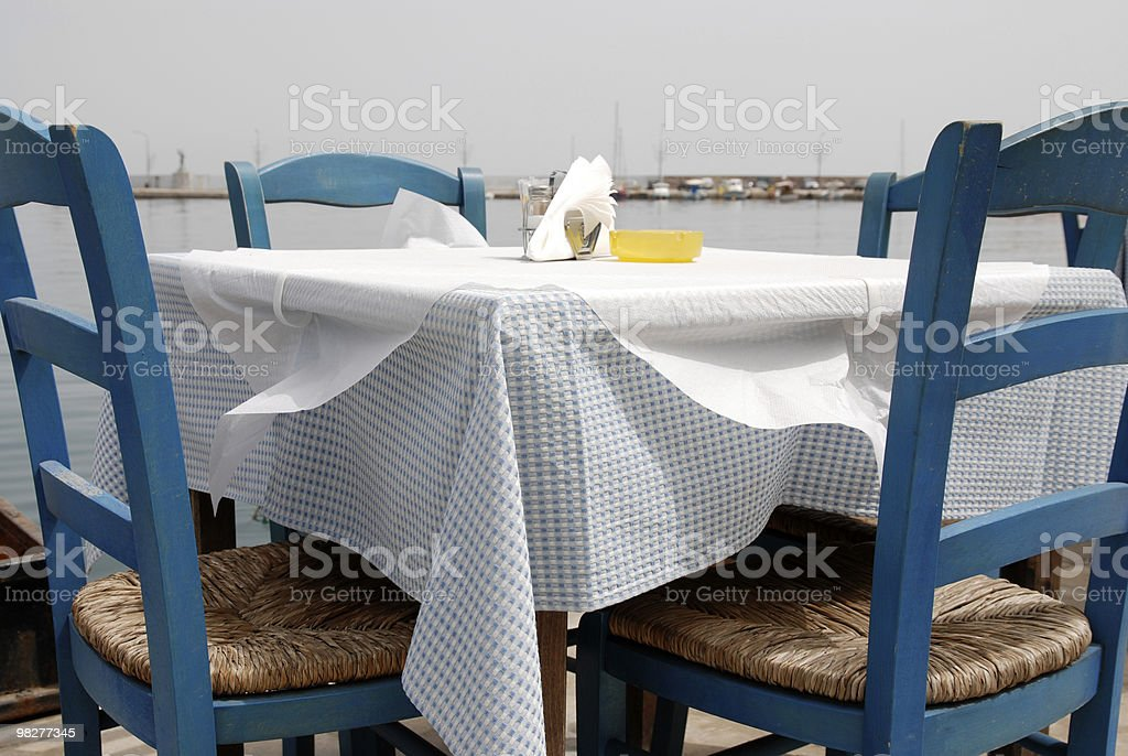 table for four outdoor with view to port of Gythion royalty-free stock photo