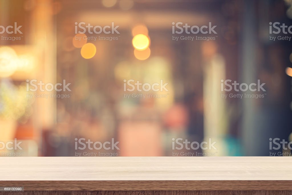 Table for product placement or montage and blurred coffee shop stock photo