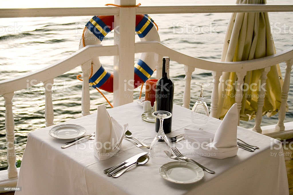 A table for romantic dinner nearby the sea stock photo
