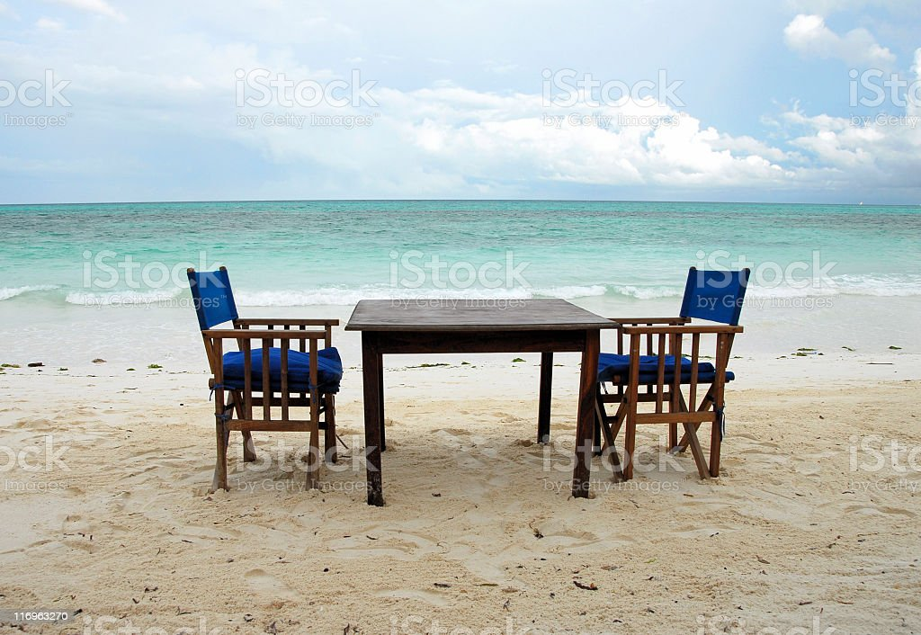 Table for two at a tropical beach in Zanzibar stock photo