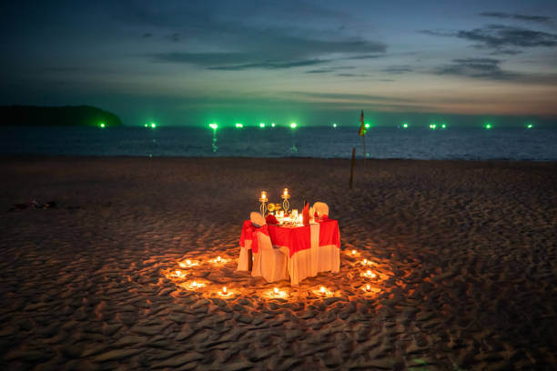 Table for two at the beach, Langkawi, Malaysia Langkawi, Malaysia: A lovely decorated table for two at the Cenang Beach of Langkawi Island. wasser photos stock pictures, royalty-free photos & images