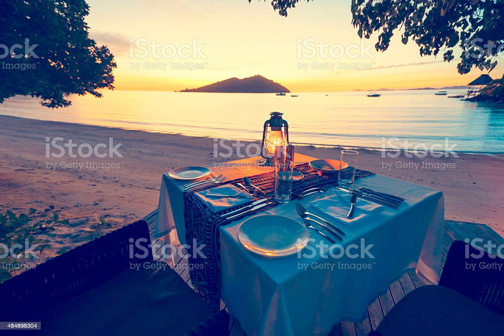 Table for two on the beach stock photo