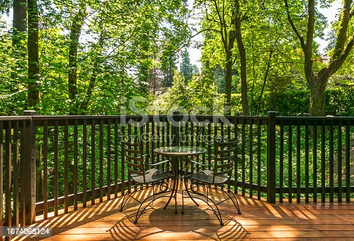 Cafe table for two on wooden deck with wooded view