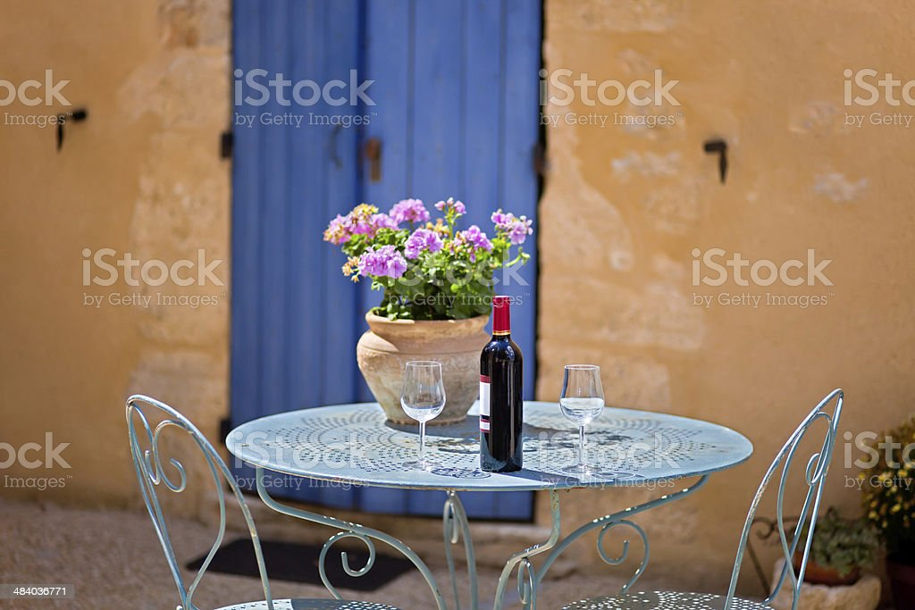 Table for two set with red wine. Provence, France. stock photo