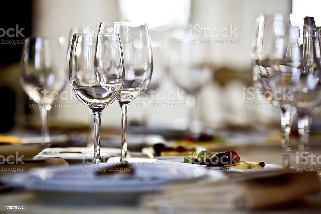 A table full of empty glasses in a restaurant stock photo