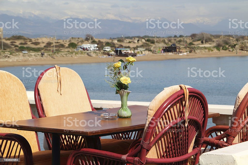 table in a restaurant on the sea royalty-free stock photo