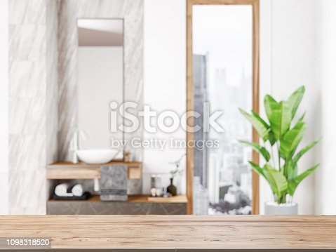 istock Table in front of blurred bathroom 1098318520