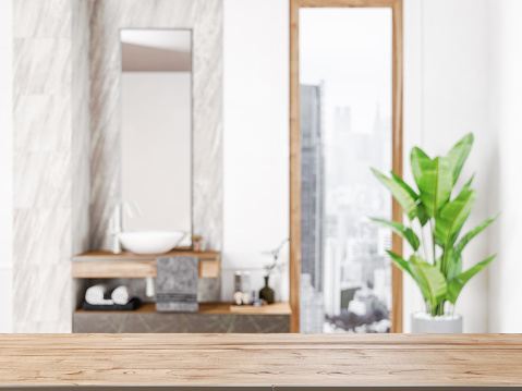 Table in front of blurred bathroom