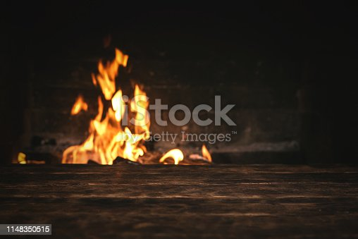 istock Table in front of fireplace. 1148350515