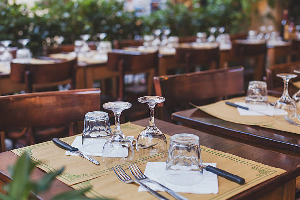 table in the restaurant in europe - pizzeria stock photos and pictures