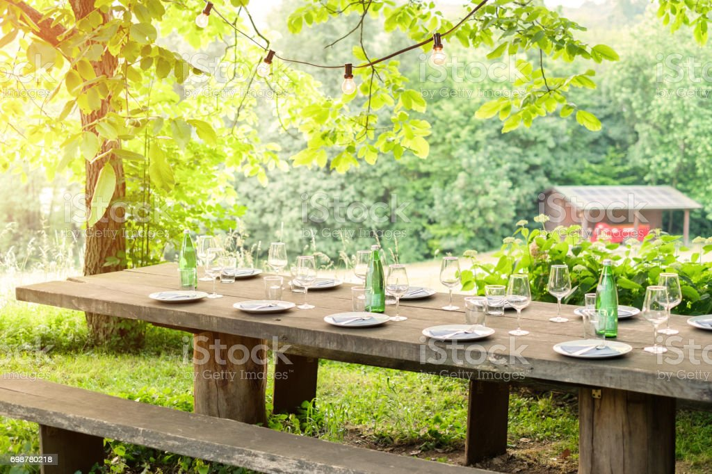 Table is set and waiting for dining in countryside - foto stock