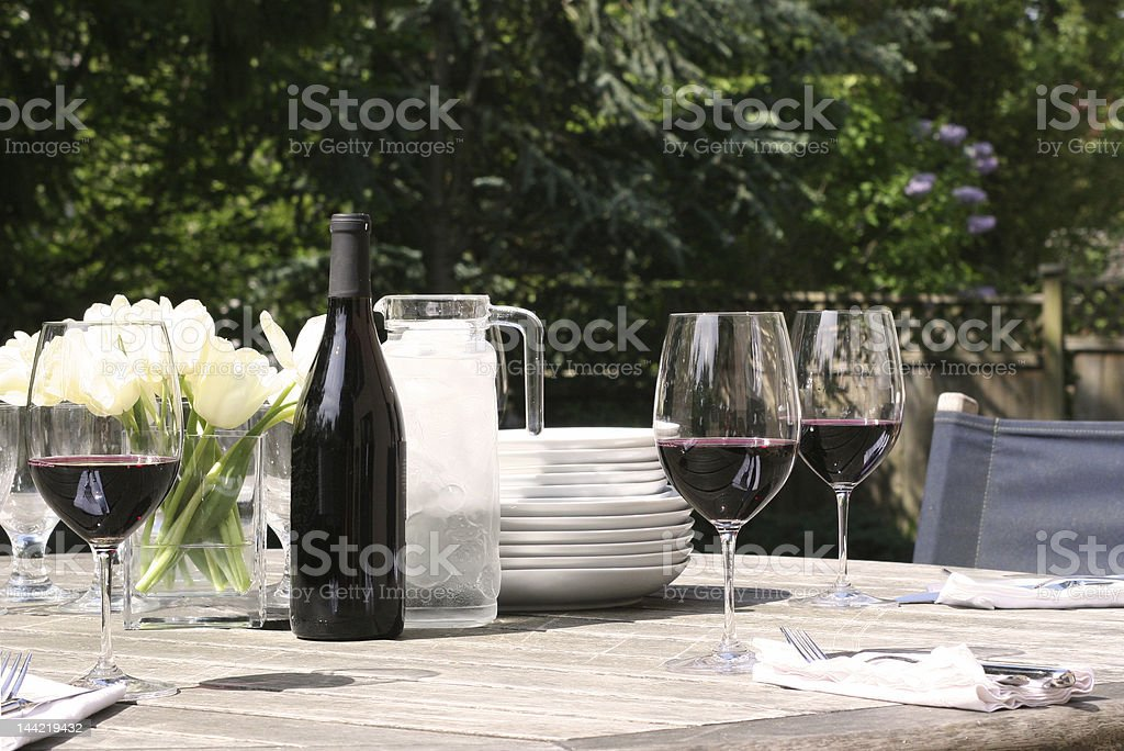 table is set for garden lunch stock photo
