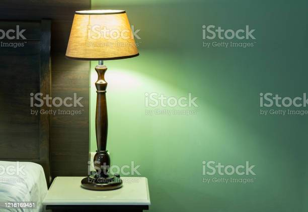 Table lamp on bedside in the bedroom picture id1218169451?b=1&k=6&m=1218169451&s=612x612&h=zov6qzxe0kztezt z xc5 oeqpqtg6ts7ocjp3lsedu=