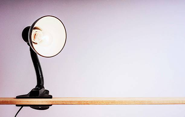 Table lamp on the clothespin stock photo