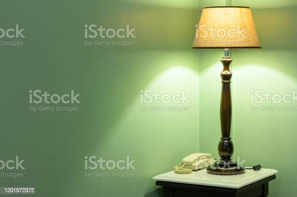 Table lamp with phone on bedside in the bedroom picture id1201572372?b=1&k=6&m=1201572372&s=612x612&h=njlanjpaoksgsqcslspxhmlhn38eitikyiqzgfpt5be=