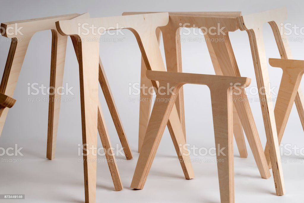 Table Legs Made of Plywood of Various Sizes on Gray Background stock photo