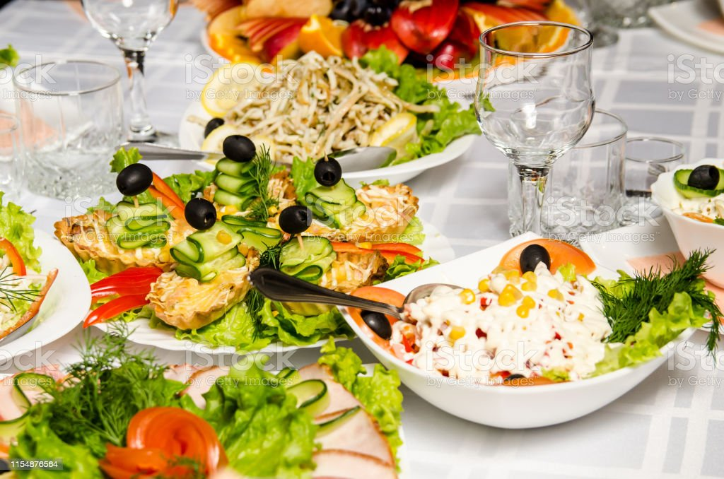 table lined with variety of dishes from which the centerpiece is dish...