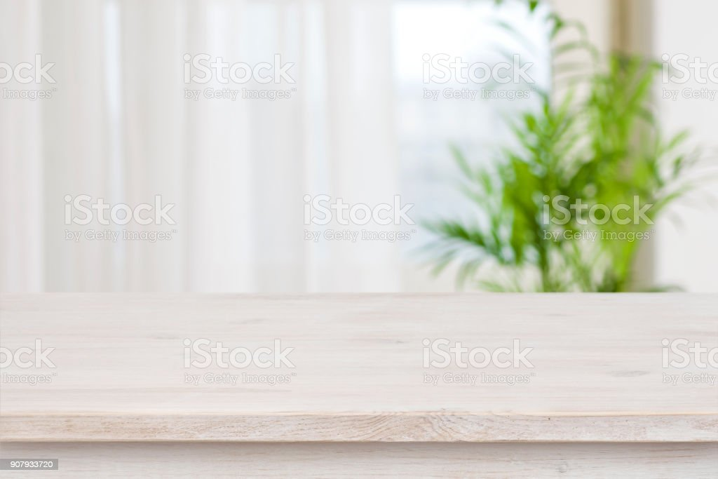 Table mockup for display of product over blurred window background stock photo