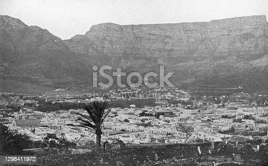 Table Mountain and a cityscape of Cape Town, South Africa. Vintage photo etching circa 19th century.