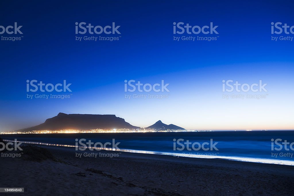 Table Mountain at dusk seen from across bay royalty-free stock photo