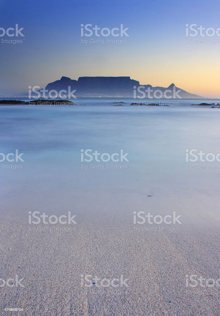 Table Mountain Beach in Foreground Evening stock photo