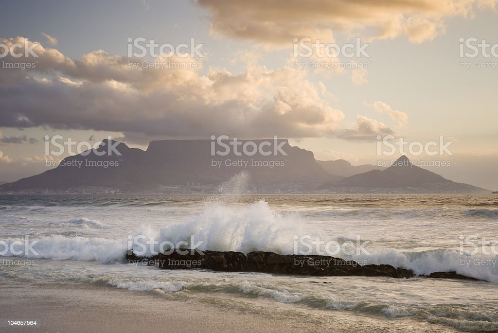 Table mountain behind crashing wave royalty-free stock photo