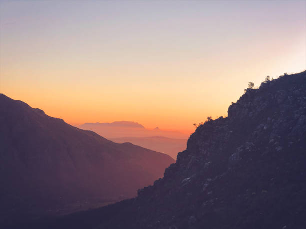 Table Mountain from Stellenbosch Mountains at sunset stock photo