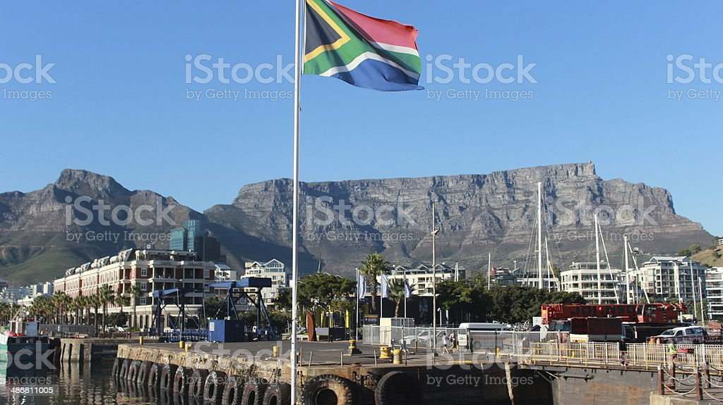 table mountain with South African flag stock photo