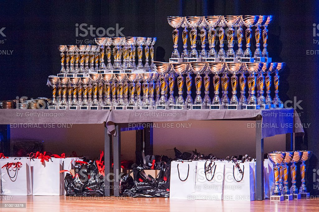 Table of thophies and goodie bags at championship stock photo