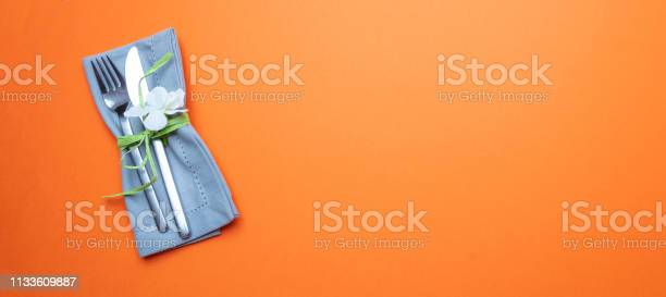 Table place setting in orange gray linen napkin and cutlery on orange picture id1133609887?b=1&k=6&m=1133609887&s=612x612&h=ckodmisaq l7z kfknbb27b72srlnp60ipir9n92pmc=
