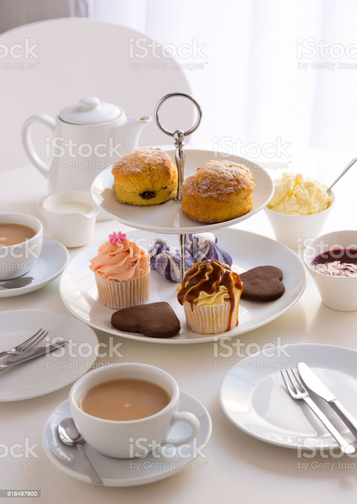 table place setting with english cream tea and cupcakes royalty-free stock photo & Table Place Setting With English Cream Tea And Cupcakes Stock Photo ...