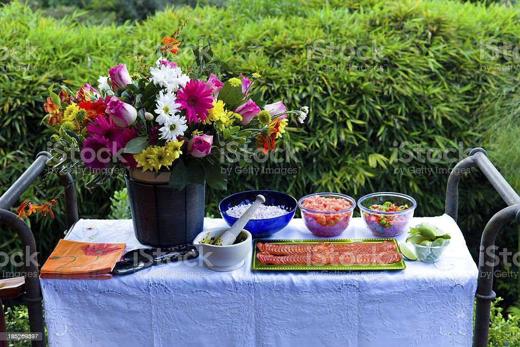Table Prepared for Outside Cooking in Garden royalty-free stock photo