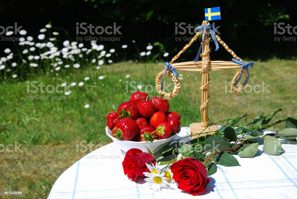 Table ready for swedish midsummer celebration stock photo