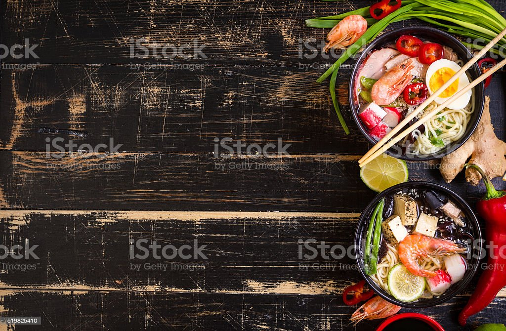 Table served with asian noodle soup background stock photo